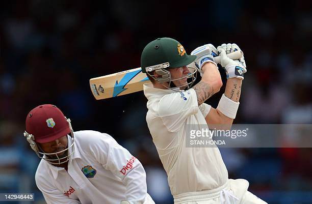 Batsman Michael Clarke of Australia plays a shot that was caught out by Shane Shillingford of West Indies during the first day of the secondofthree...