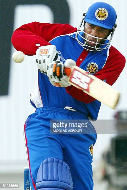 US batsman Rohan Alexander plays a stroke against New Zealand at the Oval cricket ground in London 10 September 2004 during the ICC Champions Trophy...