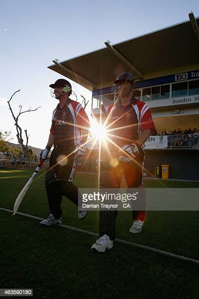 Batsmen for the ACA masters walk out to play against the Imparja Cup All Stars on February 9 2015 in Alice Springs Australia
