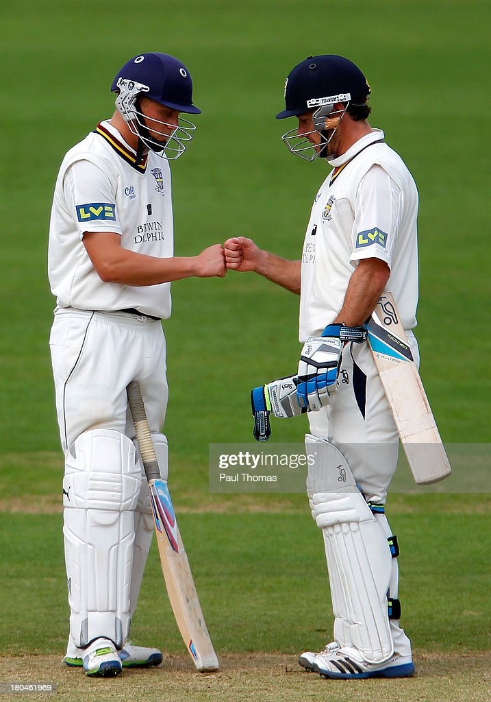 Batsmen Scott Borthwick (L) and Will Smith of Durham share a moment during the LV County Championship match between Derbyshire and Durham at The County Ground on September 13, 2013 in Derby, England.
