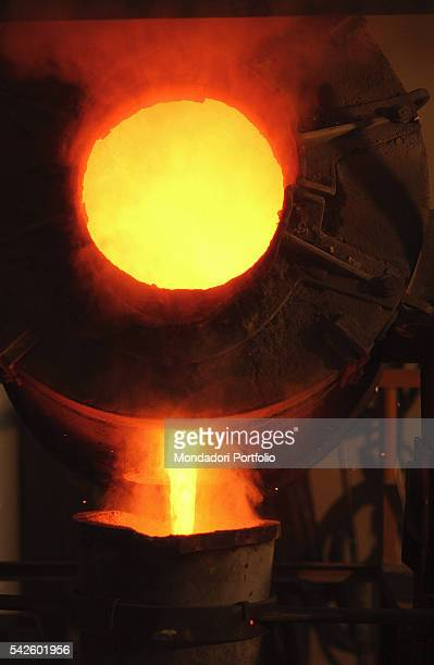 Battaglia artistic foundry in Milan This is the foundry where the works by Italian sculptor Arnaldo Pomodoro are made The redhot crucible containing...