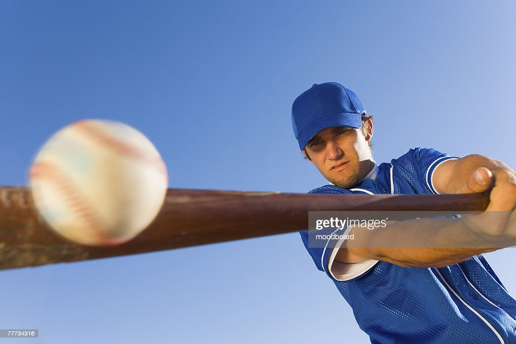 Batter Hitting Baseball : Stock Photo