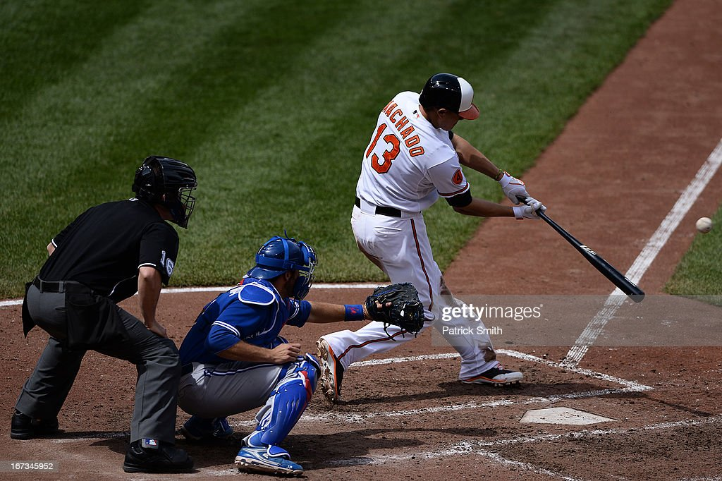 Batter Manny Machado #13 of the Baltimore Orioles hits a triple in the seventh inning against the Toronto Blue Jays at Oriole Park at Camden Yards on April 24, 2013 in Baltimore, Maryland. The Toronto Blue Jays won, 6-5.