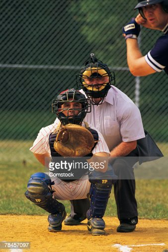 Batter with catcher and umpire at home plate
