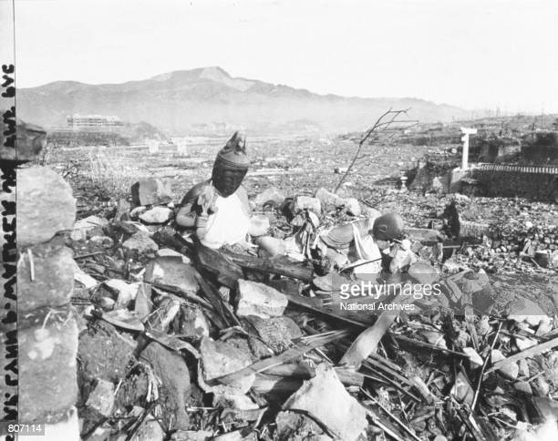 Battered religious figures stand on a hill above a tattered valley September 24 1945 after the Americans dropped an atomic bomb in Nagasaki Japan