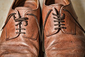 Battered tan leather laced shoes