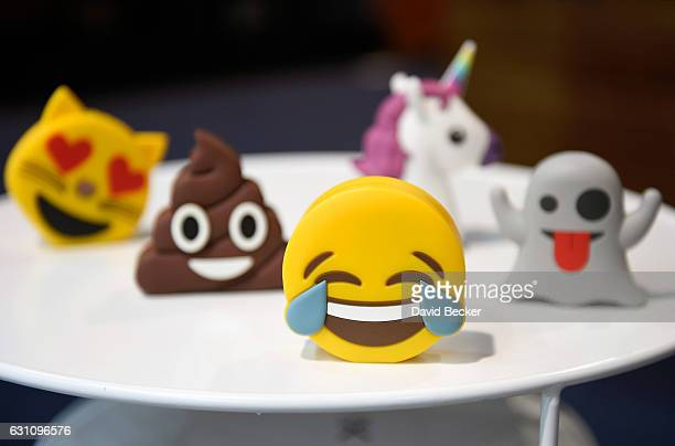 Batteries designed as emojis are displayed at the Philo booth at CES 2017 at the Las Vegas Convention Center on January 6 2017 in Las Vegas Nevada...