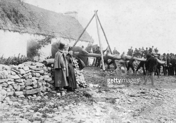 A battering ram is used to break into a house on the estate of Captain Hector Vandeleur in County Clare during an eviction of tenants for the...