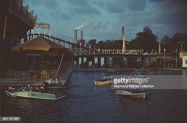 Battersea Fun Fair in Battersea Park London with Battersea Power Station visible in the background circa 1965 The John Collins Big Dipper was the...