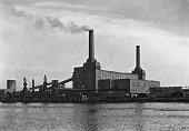 Battersea Power Station a coalfired power station on the south bank of the River Thames in London circa 1935 It is pictured here between the...