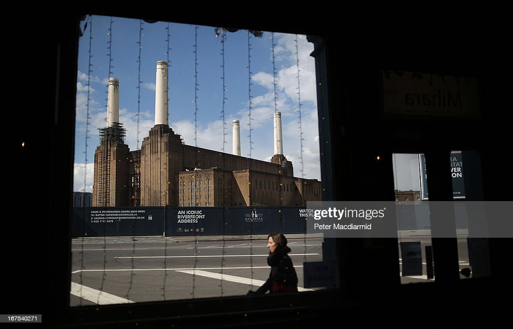 Battersea power station dominates the view from a nearby pub on April 26, 2013 in London, England. Built in the 1930s, with an identical second section added in the 1950s, the Grade II* listed building last generated electricity in 1983. The 15.7 hectare site on the south bank of The River Thames is being re-developed. Over the next 11 years 3400 homes, office space and a theatre will be built in and around the power station which is still the largest brick building in Europe.