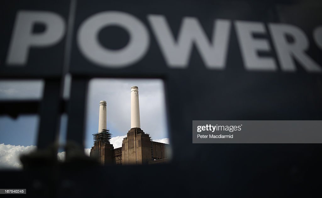 Battersea power station is glimpsed through a gap in an advertising hoarding on April 26, 2013 in London, England. Built in the 1930s, with an identical second section added in the 1950s, the Grade II* listed building last generated electricity in 1983. The 15.7 hectare site on the south bank of The River Thames is being re-developed. Over the next 11 years 3400 homes, office space and a theatre will be built in and around the power station which is still the largest brick building in Europe.