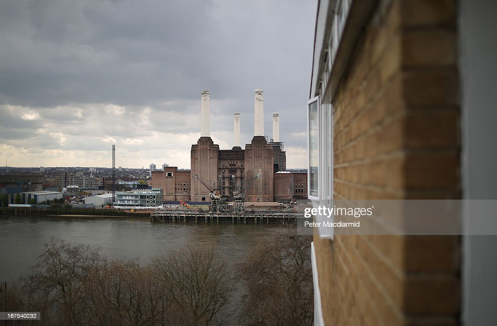 Battersea power station seen from a tower block in Pimlico on April 26, 2013 in London, England. Built in the 1930s, with an identical second section added in the 1950s, the Grade II* listed building last generated electricity in 1983. The 15.7 hectare site on the south bank of The River Thames is being re-developed. Over the next 11 years 3400 homes, office space and a theatre will be built in and around the power station which is still the largest brick building in Europe.
