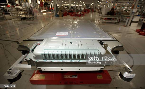 A battery awaits installation in a Telsa Motor Inc Model S sedan at the company's assembly plant in Fremont California US on Wednesday July 10 2013...