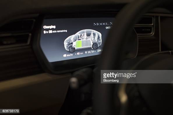 Battery charging status information is displayed on a dashboard screen inside a Tesla Model X sports utility vehicle during assembly for the European...