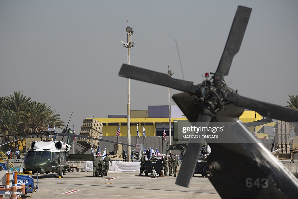 A battery of Iron Dome, short-range missile defence system, is seen behind a US Marine helicopter on the tarmac of Israel's Ben Gurion airport ahead of the arrival of US President Barack Obama on March 20, 2013. Obama was on his way to Israel for the first time as US president, hoping to ease past tensions with his hosts and under pressure to narrow differences over handling Iran's nuclear threat.