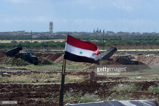 A battery of the Syrian Army's Russian made the BM21 'Grad' multiple rocket launcher is visible in Hama province in the northwest of Syria on May 4...