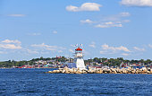 Battery Point Breakwater Lighthouse with Lunenburg in the background -Nova Scotia