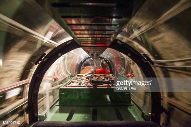 01 GMT / A Battery power train carrying members of the media inside the Mail Rail tunnels is seen as part of the press preview of the new Postal...