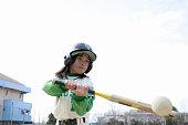 Batting baseball girls