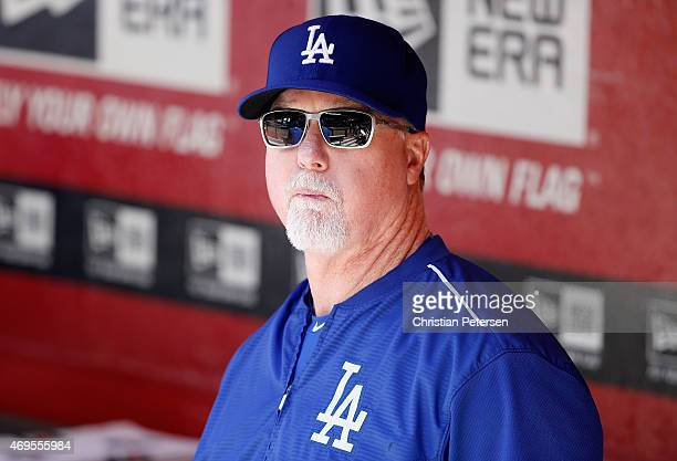 Batting coach Mark McGwire of the Los Angeles Dodgers in the duogut during the MLB game against the Arizona Diamondbacks at Chase Field on April 12...