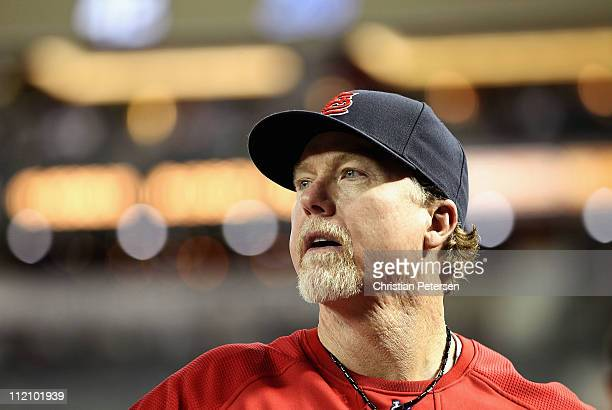 Batting coach Mark McGwire of the St Louis Cardinals watches from the dugout during the Major League Baseball game against the Arizona Diamondbacks...