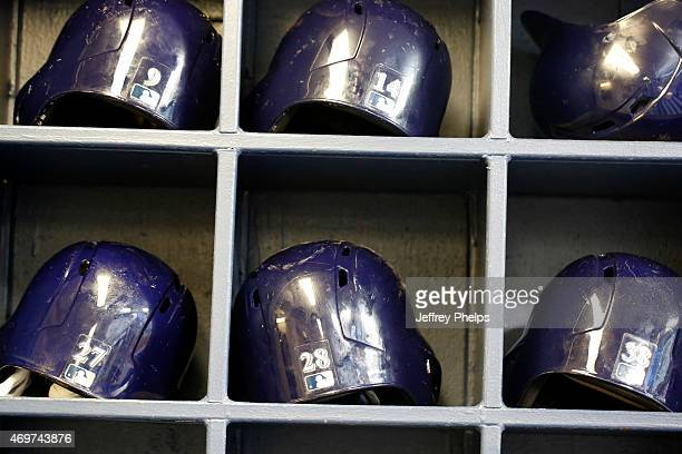 Batting helmets in the Milwaukee Brewers dugout before the game against the Colorado Rockies at Miller Park on April 8 2015 in Milwaukee Wisconsin