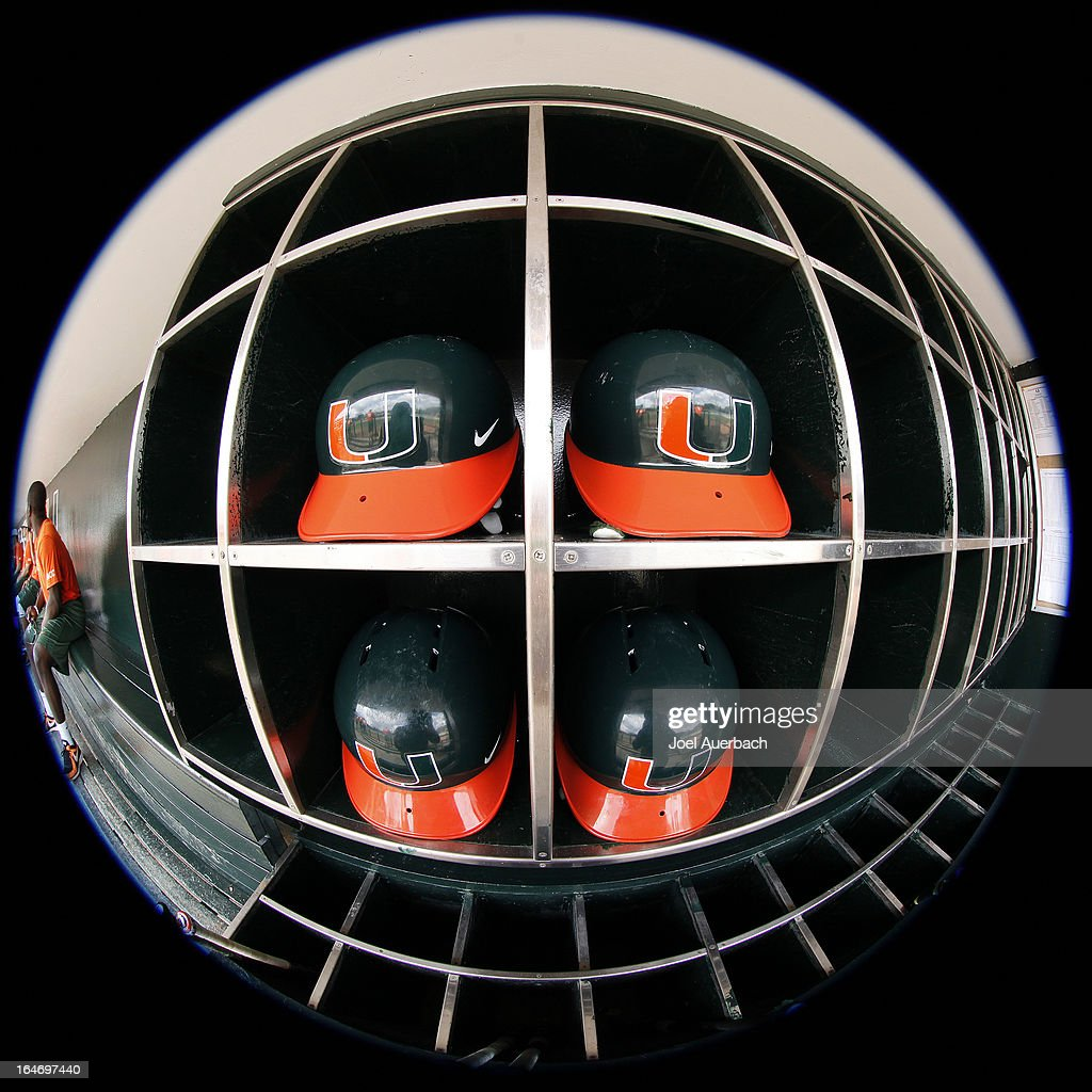 Batting helmets used by the Miami Hurricanes sit in a rack in the dugout prior to the game against the Virginia Tech Hokies on March 24, 2013 at Alex Rodriguez Park at Mark Light Field in Coral Gables, Florida. Virginia Tech defeated Miami 8-5 in 10 innings.