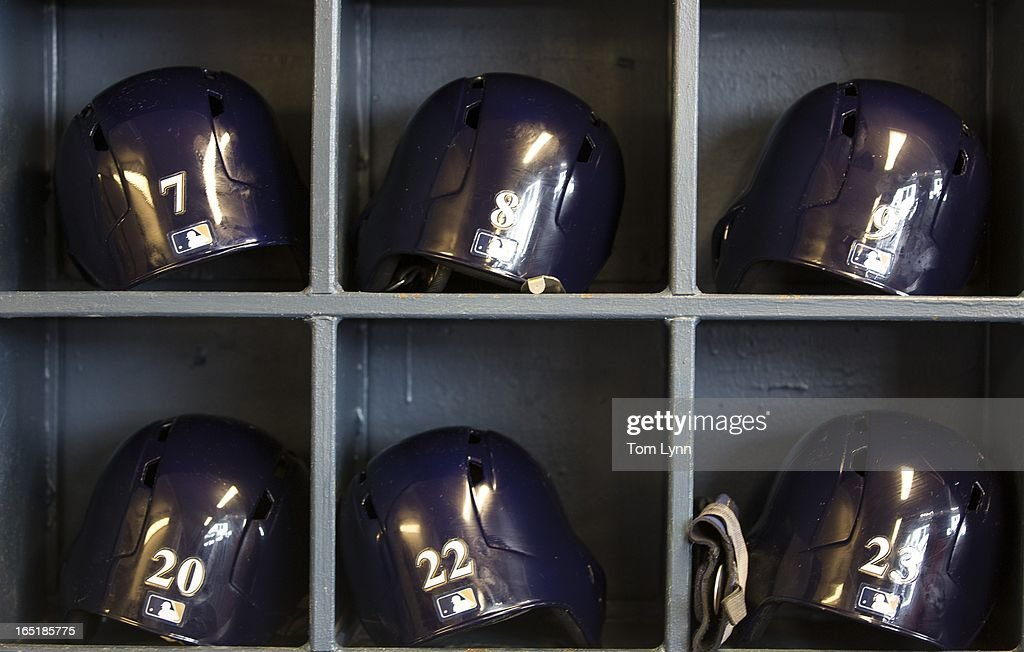 Battings helmets sit on shelves in the Milwaukee Brewers' dugout for the game against the Colorado Rockies on opening day at Miller Park on April 1, 2013 in Milwaukee, Wisconsin.