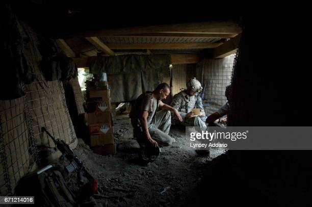 PROVINCE AFGHANISTAN SEPTEMBER 2 2007 Battle Company troops rest inside a bunker of a new outpost his platoon fought hard to establish after the...