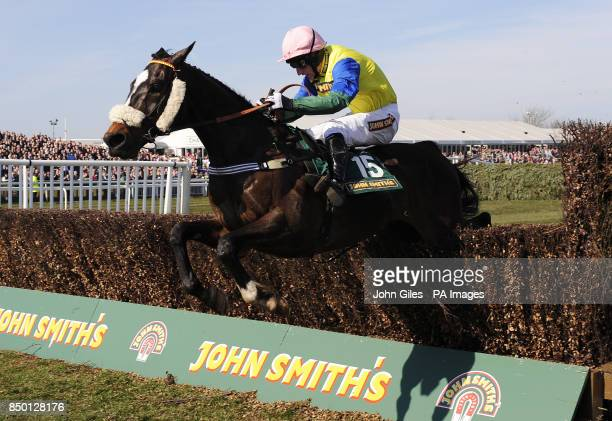 Battle Group and Daryl Jacob lead over the final fence as they win the John Smith's Handicap Chase during Grand National Day at the 2013 John Smith's...