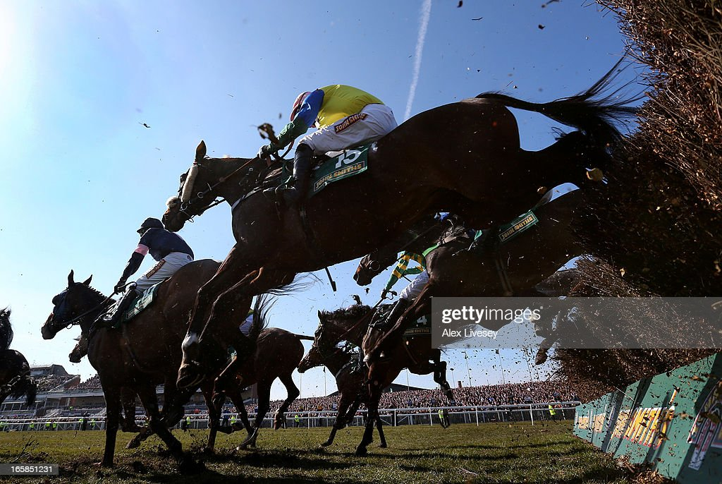 Battle Group ridden by Daryl Jacob clears a fence on their way to victory in The John Smith's Handicap Steeple Chase at Aintree Racecourse on April 6, 2013 in Liverpool, England.