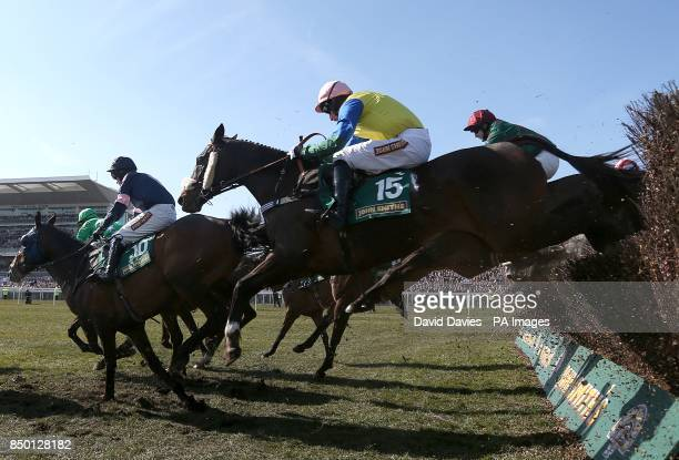 Battle Group ridden by jockey Daryl Jacob jumps the last on the way to victory in the John Smith's Handicap Chase during Grand National Day at...