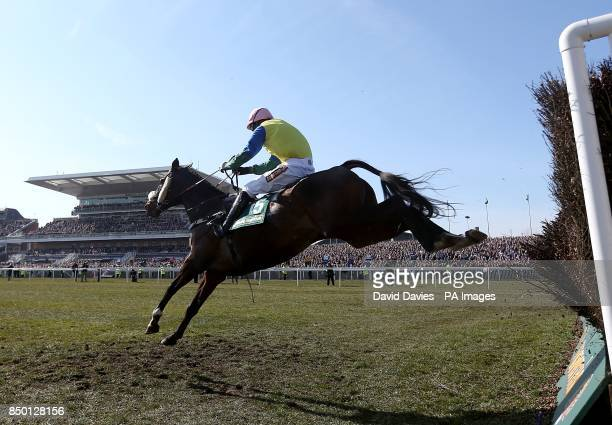 Battle Group ridden by jockey Daryl Jacob on the way to victory in the John Smith's Handicap Chase during Grand National Day at Aintree Racecourse...
