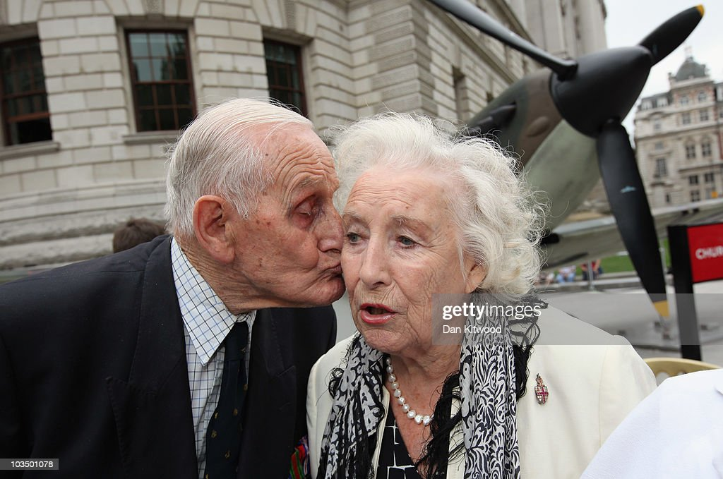 A Battle of Britain Veteran kisses Dame Vera Lynn in front of a Mark IV Supermarine Spitfire replica, owned by the Imperial War Museum outside the Churchill War Rooms museum as part of the Battle of Britain anniversary celebration on August 20, 2010 in London, England. This year commemorates the 70th Anniversary of the Battle of Britain.