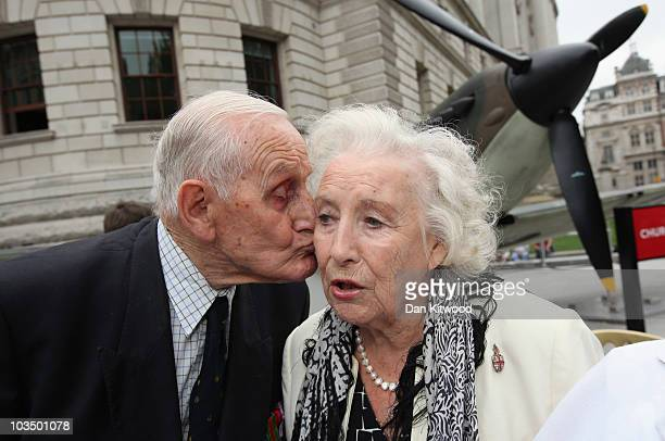 Battle of Britain Veteran kisses Dame Vera Lynn in front of a Mark IV Supermarine Spitfire replica owned by the Imperial War Museum outside the...