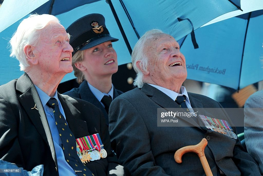 Battle of Britain veterans Wing Commander TF Neil, 249 Squadron Hurricaines (L) and Geoffrey Harris Augustus Wellum, 92 Squadron Spitfires, sit in front of Buckingham Palace to watch the RAF flypast to commemorate the 75th Anniversary Of The Battle Of Britain on July 10, 2015 in London, England.