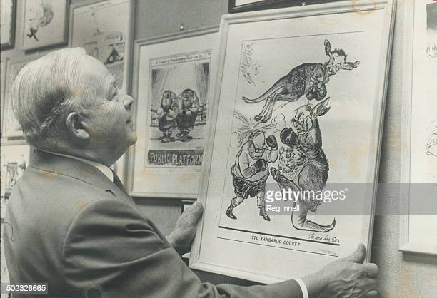 Battle relics of his political jousts framed cartoons almost cover the wall of former mayor Allan Lamport's office in City Hall Here he looks fondly...