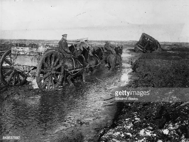 Battles of the Somme Ammunition limber taking ammunition forward along the Lesboeufs Road outside Flers November1916 The Horses are above their knees...
