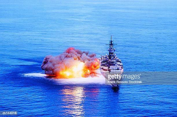 Battleship USS Iowa (BB-61) firing guns