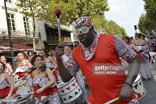 A Batucada drum band performs on September 7 2014 in a street of Paris as part of a 'Peace parade' organized by the Brazilian community AFP PHOTO...
