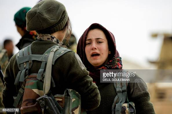 Batul a 21yearold female Arab fighter among the Syrian Democratic Forces made up of USbacked Kurdish and Arab fighters talks with another fighter...