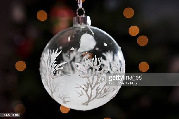 Bauble hanging in front of christmas lights.