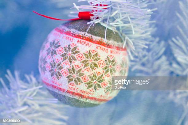 Bauble hanging in white Christmas tree