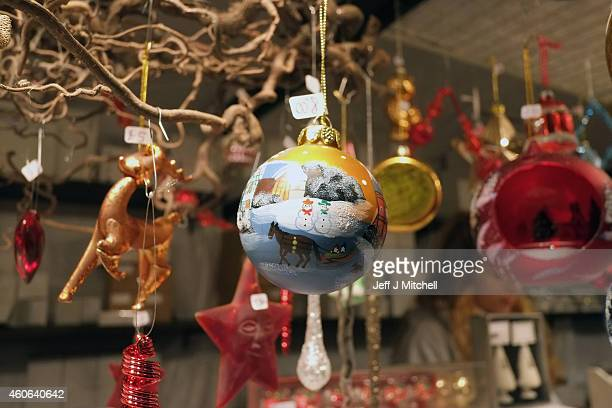 Baubles are sold at the Christmas Market one of a number of attractions situated in Princes Street Gardens in Edinburgh along with an ice rink...