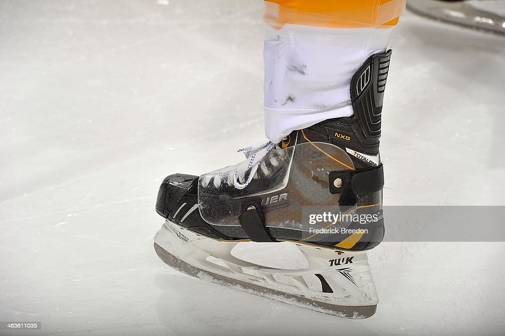 A Bauer skate is used on the ice during a game between the Nashville Predators and the Calgary Flames at Bridgestone Arena on January 14, 2014 in Nashville, Tennessee.