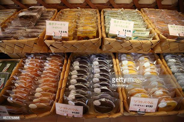 Baumkuchen cakes and donuts are displayed inside a Kimuraya bakery in Rikuzentakata Iwate prefecture Japan on Saturday Jan 17 2015 President Masayuki...
