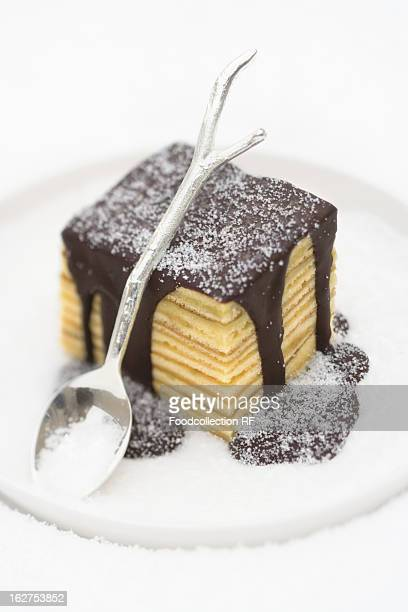 Baumkuchen (German layer cake) with chocolate sauce and sugar