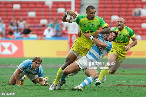 Baustita Ezcurra of Argentina tries to tackle Frankie Winterstein of Australia during the 2016 Singapore Sevens at National Stadium on April 16 2016...
