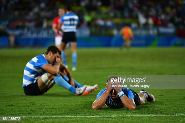 Bautista Ezcurra of Argentina lies dejected following an extra time try by Dan Bibby of Great Britain to win the match during the Men's Rugby Sevens...